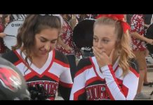Video Football players' kind gesture to cheerleader goes viral