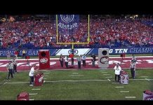 Video Girl wins $100,000 throwing football with two hands